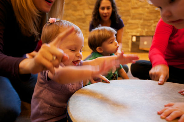 Children play drums. Music helps kids learn numbers.
